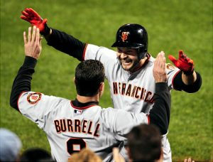 The Giants' Cody Ross celebrates his second HR in Game 1 of the NLCS.