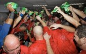 Josh Hamilton celebrates with his teammates in a shower of Ginger Ale, as opposed to champagne, thoughtful of his issues with alcohol.