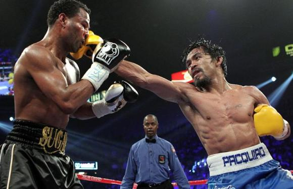 """In predictable fashion, pound-for-pound champ Manny Pacquiao laid waste to """"Sugar"""" Shane Mosley in a lopsided unanimous decision. (Courtesy mosley-vs-mayweather-fight.blogspot.com)"""