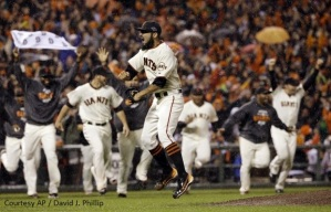 Giants Closer Sergio Romo (center) celebrates the final out in the NLCS as his teammates rush the field, completing another epic comeback to reach their second World Series in three years.