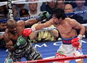Manny Pacquiao (right) avenged his 2012 loss to Timothy Bradley Jr. to regain the WBO  Welterweight Championship.