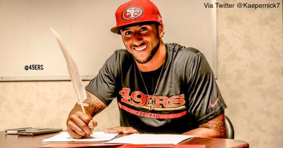 This is a sigh of relief for 49ers fans: a picture of QB Colin Kaepernick signing his new contract. The deal is reported to pay him $18 million a year.