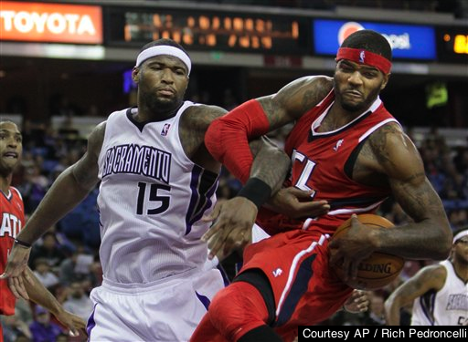 Josh Smith (right) joining forces with Sacramento's DeMarcus Cousins might help him recover from a career stumble in Detroit.