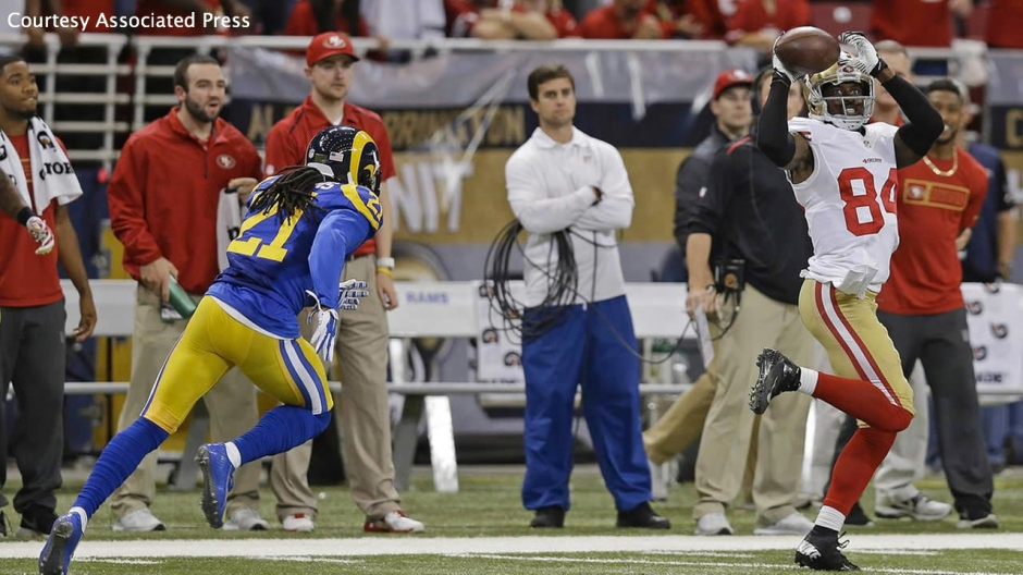 49ers WR Brandon Lloyd's (right) 80-yard score before the half sparked another San Francisco comeback in St. Louis.